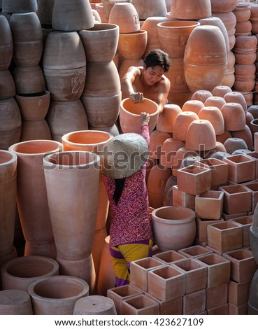 Vinh Long, Vietnam, April 14, 2016 workers, traditional pottery, Vinh Long province, Vietnam