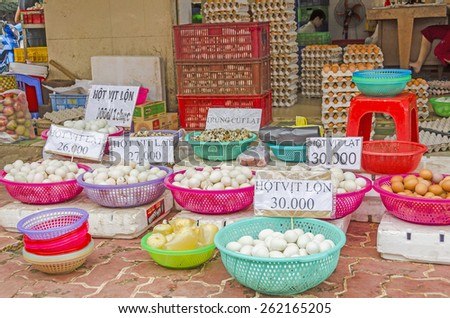 VINH LONG, VIETNAM, JANUARY 3, 2013: Different kind of eggs on display at food stalls along the street in Vinh Long market - stock photo