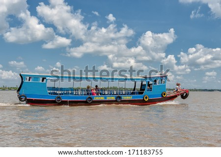 VINH LONG, VIETNAM - MARCH 6: Traditional colorful river boat on March 6, 2009 in Vinh Long. The Mekong river is a major route for transportation in Southeast Asia.