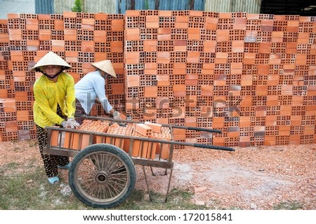 VINH LONG, VIETNAM - MARCH 7: Women work in a brickworks in the Mekong delta on March 7, 2009 near Vinh Long. The Mekong delta has become popular among tourists wishing to experience rural Vietnam.