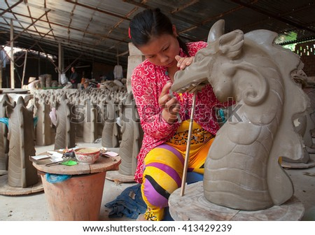 Vinh Long, Vietnam, September 27, 2015 the woman, traditional pottery, rural Vinh Long, Vietnam