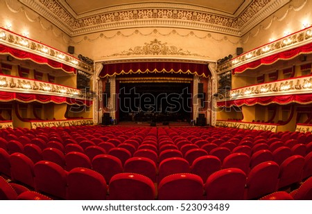 Vinnitsa,Ukraine - December 13,2015.Central Golden Hall. interior of a conference hall.The interior of the hall in the theater.View of an empty theatre with red seats and balcony