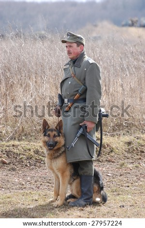 VINNITSA, UKRAINE - MAR 21: A member of history club called Red Star wears historical German uniform as he participates in a WWII reenactment March 21, 2009 in Vinnitsa, Ukraine.