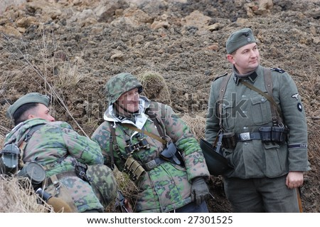 VINNITSA, UKRAINE - MAR 21: Members of a history club called Red Star wear historical German uniform as they participate in a WWII reenactment in Vinnitsa, Ukraine on March 21, 2009.