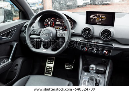 Vinnitsa,Ukraine - May 14, 2017.Audi Q2 concept car.Front of the car,front-side, logo Audi,TFSI,modern car.Presentation of the new model car - Audi Q2.Inside the car,steering wheel,interior of the car