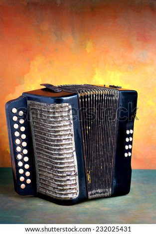 Vintage accordion musical instrument on grunge still life style - stock photo
