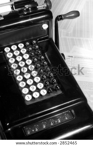 Vintage Adding Machine and Tax Return (Black and White) - stock photo