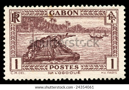 vintage African stamp from Gabon depicting native worker on logging raft on the Ogooue river - stock photo