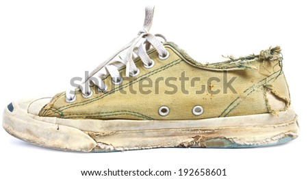 vintage age-worn sneakers on a white background - stock photo