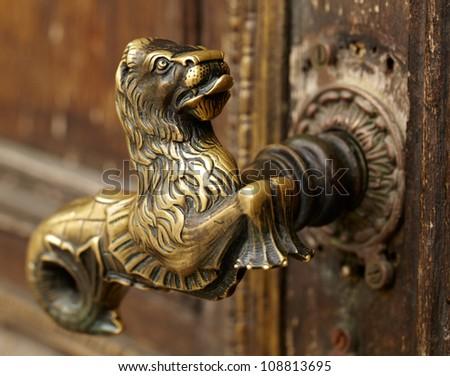 Vintage aged door handle in Tallinn, Estonia - stock photo