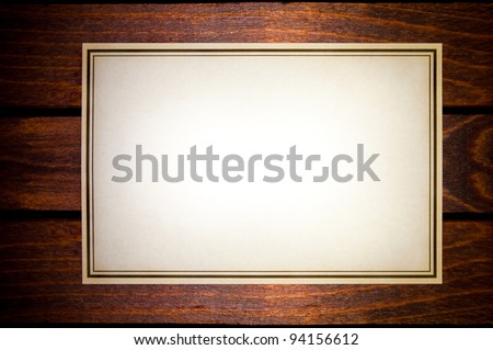 Vintage aged old paper on a wooden table - stock photo