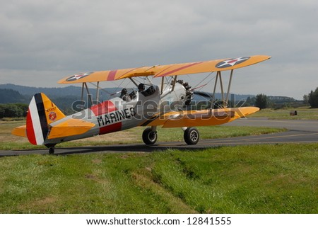 Vintage aircraft at a local air show on display and flying - stock photo