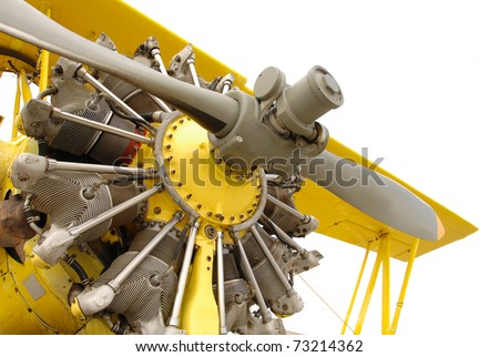 Vintage airplane engine in yellow