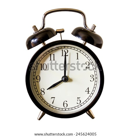 vintage alarm clock at 8 o'clock in the morning - stock photo