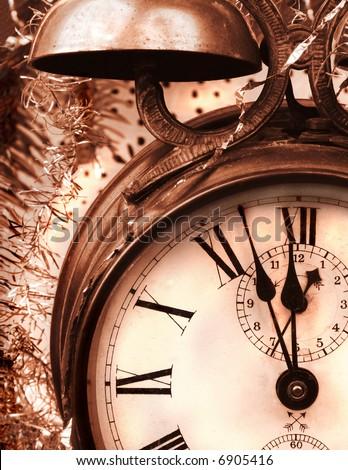 Vintage alarm-clock in brown tone. New Year celebration - stock photo
