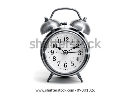 vintage alarm clock isolated. - stock photo