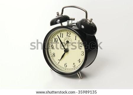 vintage alarm clock isolated over white