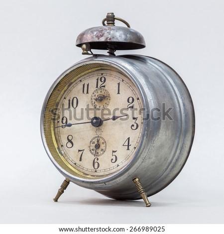 vintage alarm clock on a white background - stock photo