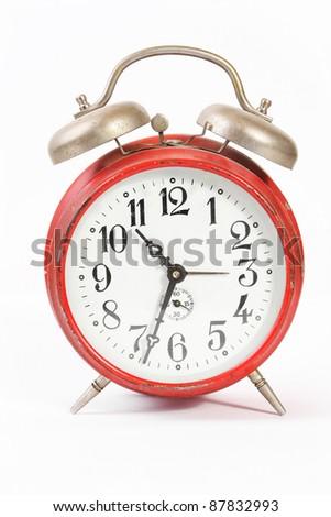 Vintage alarm clock on white background - stock photo