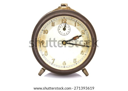 vintage alarm clock over white isolated - stock photo