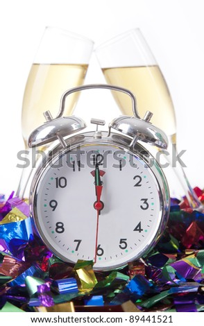 Vintage Alarm clock with champagne glass isolated on white