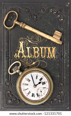 vintage album book with old key and clock decoration - stock photo