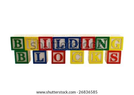 Vintage alphabet blocks spelling out the words Building Blocks - stock photo