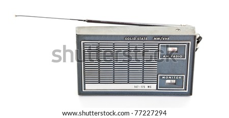 Vintage AM and police frequencies transistor radio.  Isolated on white background.