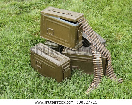 Vintage Ammunition Bullets and Metal Carry Cases. - stock photo
