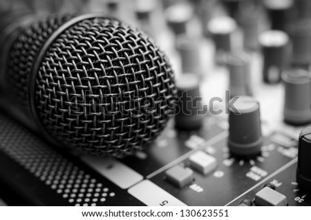 Vintage amplifier close up and microphone - stock photo