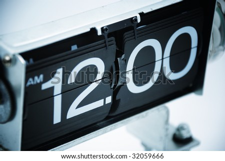 Vintage Analog Clock displays Midnight - stock photo