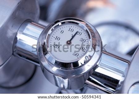 Vintage analog motorbike engine temperature indicator - stock photo