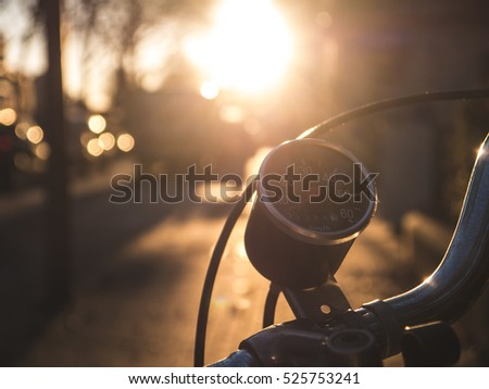 Vintage analog speedometer on old bicycle with golden winter sun