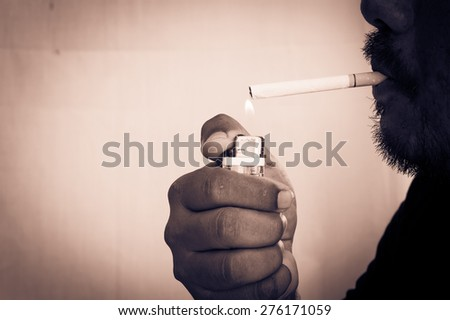 vintage and old photo of man smoking cigarette lighting up,focus hand