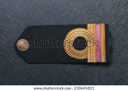 Vintage and old Royal Thai Navy arm made from velvet black color and gold color cloth well-knit represent Thai navy arm accessory to use with uniform  - stock photo