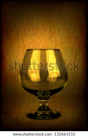 Vintage and Toned Photo of the Glass on Dark Brown Background