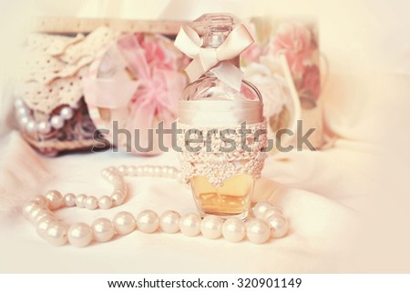 Vintage antique perfume bottles, on wooden table. retro filtered image