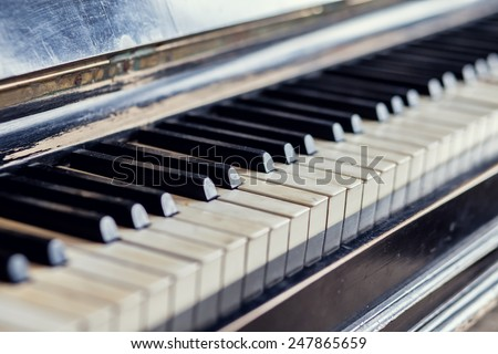 Vintage antique piano keys.shallow depth of field - stock photo