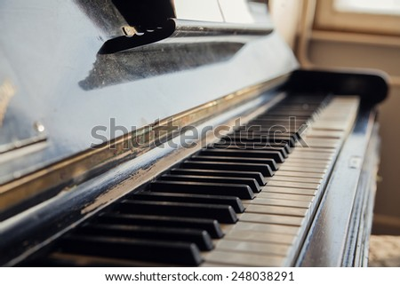 Vintage antique piano keys. Shallow depth of field - stock photo
