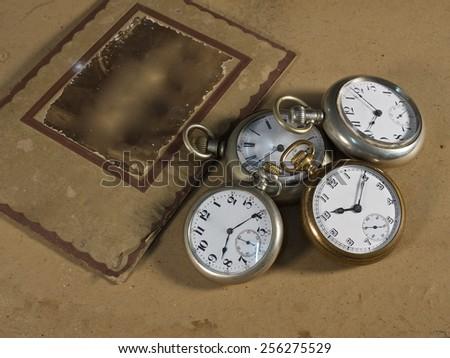 Vintage Antique pocket watch and vintage photo frame  - stock photo