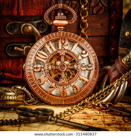 Vintage antique pocket watch on ancient stock photo royalty free vintage antique pocket watch on an ancient world map in 1565 gumiabroncs Image collections