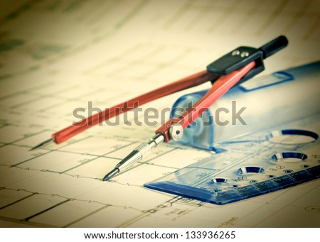 Vintage architectural drawing with a ruler and compass - stock photo