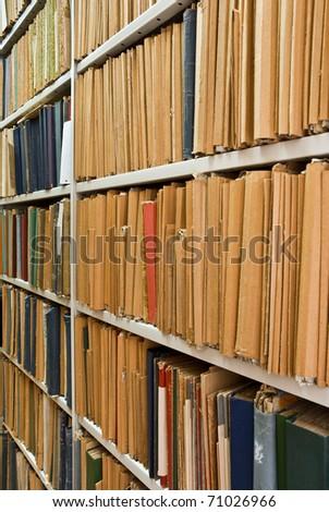 Vintage Archival documents folder on the shelves - stock photo