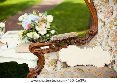 vintage armchair with wedding bouquet - stock photo