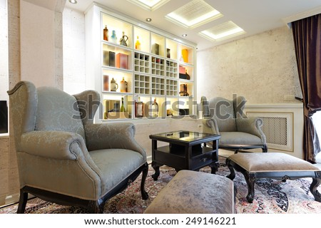 vintage armchairs in classic home interior - stock photo