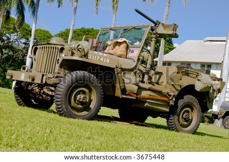 Vintage army WWII Jeep on display with fifty cal machine gun