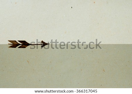 vintage arrow printed on antique grey paper texture - stock photo