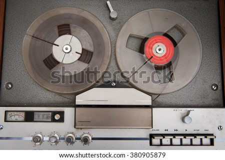 Vintage audio tape music recorder with reels and knobs - stock photo