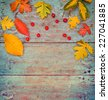 Vintage Autumn border from berries and  fallen leaves on rustic table/ Thanksgiving day concept/ Autumn background with fallen leaves and copyspase  - stock photo