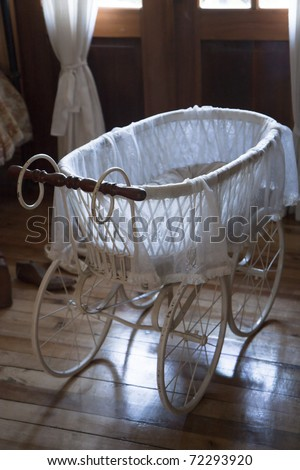 Vintage baby carriage in a room